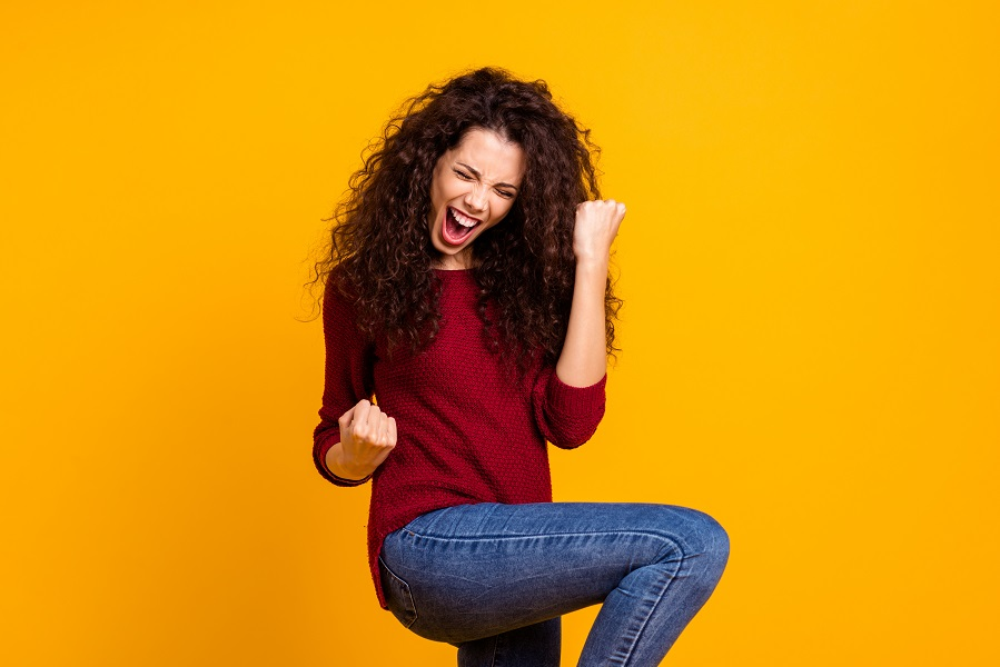 happy woman celebrating - things to do to boost your progesterone - Diagnost