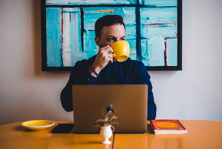 man drinking coffee - how to reduce cortisol - diagnost