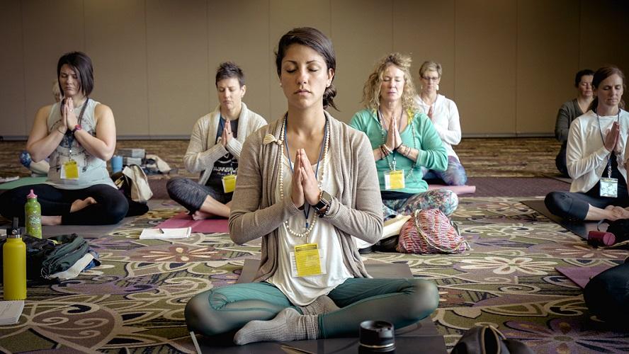 woman meditating to reduce stress